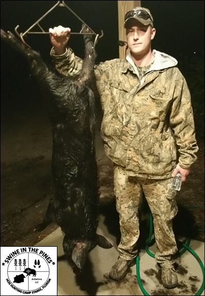 Charles with his 100lb Boar taken at Swine In The Pines Hog Hunting Camp in Northeast Florida