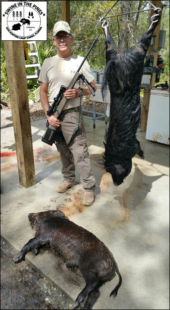 David and his Wild Pig after a Great Morning Hunt at Swine In The Pines in Northeast Florida