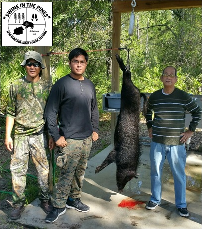 Irineo, John-Paul, and Celso with this nice 108lb Wild Boar taken at Swine In The Pines Hog Hunting Camp