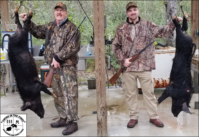 Ken and Jacob with their nice Wild Hogs taken at Swine In The Pines Hog Hunting Camp