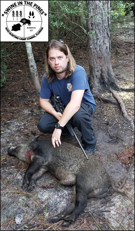 Philip with His 114lb Wild Boar taken at Swine In The Pines North Florida Hog Hunting Camp