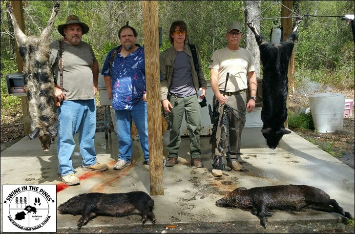 Rich, Wayne, David, and Dave after their morning hunt at Swine In The Pines Hog Hunting Camp