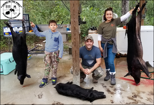 Tony, Charlie, and Sophia with their 120/75/60lb Piney Wood Rooters! taken at Swine In The Pines Wild Hog Hunting Florida Style